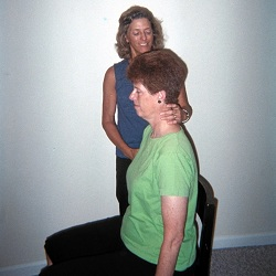 Nancy Romita works with an Alexander Technique teacher trainee