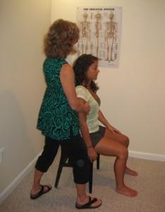 Nancy Romita works with an Alexander Technique student